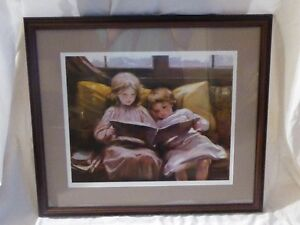 FRAMED PRINT OF 1898 PAINTING OF 2 GIRLS READING A BOOK TOGETHER