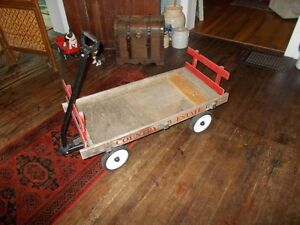 Old wooden wagon with metal handle.