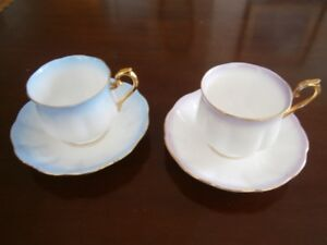 TWO ROYAL ALBERT 'RAINBOW' CUP AND SAUCER SETS