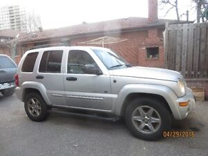 Swap 2003 4X4 Jeep Liberety for Boat motor and trailer