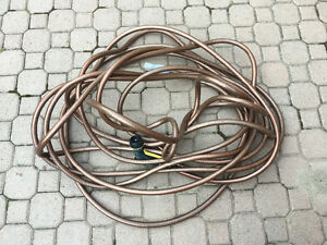 Almost new 100ft High Quality Garden Hose with Nozzle