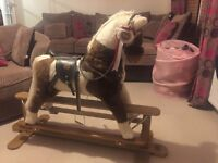 "Mamas and Papas ""patches"" the rocking horse."