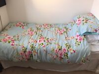 Single divan bed with mattresses and floral befset
