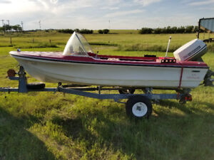 14 ft Anchor Boat with 33 Johnson motor and trailer $1500.00