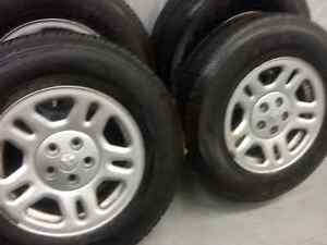4 Goodyear wrangler all season tires with Dodge mags:225/75R16