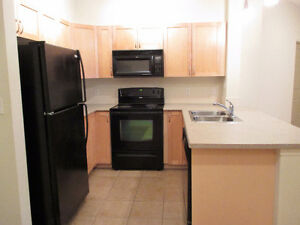 Main floor unit with large den!!!