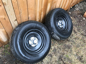 Two trailer rims and tires