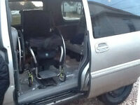 Wheelchair van with hand controls and chair lift