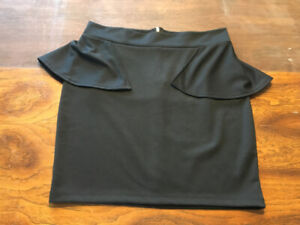 Black peplum skirt size large by Twik (Simon's), new without tag