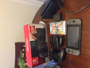 3 month old Nintendo switch with game and extra controller