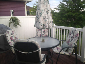 Patio table ,umbrella 4chairs and cushions,