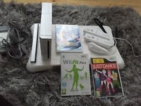 Nintendo Wii and fit board with games