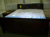 New king size sleigh bed. Head board foot board and rails. $699.