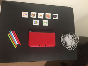 Nintendo 3DS XL (Red) Comes with 7 games and extra pens.