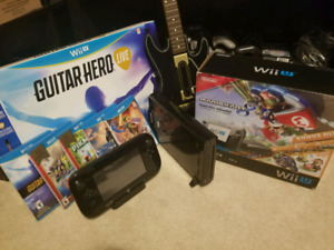 WII U PRACTICALLY BRAND NEW . With games