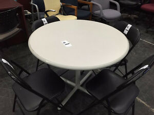 white table  / folding chairs