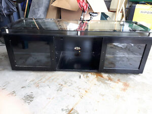 Black and brushed metal TV Stand with glass top
