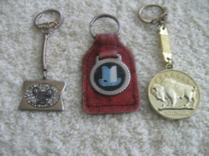 EIGHT VINTAGE COLLECTIBLE KEY RINGS...