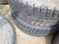 Set of 2 Michelin winter tires p235/75r15 on 6 bolt dokota