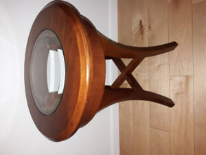 Nice solid wood circular end table with central glass panel