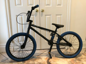 "Kids' BMX bike. Haro.  19"" aluminum alloy blue coloured wheels"