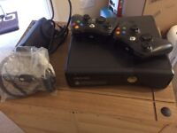 Xbox 360 with FIFA 15 and two controllers