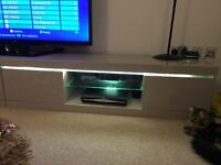Mink high gloss tv unit with storage compartments on each side and led lights
