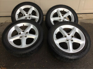 Uniroyal Tiger Paw Touring tires with alloy wheels.