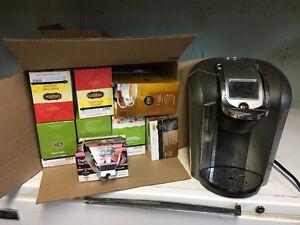 Keurig Machine and heaps of coffee & tea Supplies.