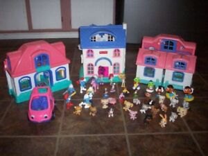 3 Fisher Price Houses and 40 Misc pieces
