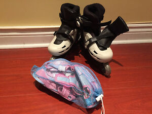 Two Pairs of adjustable Roller Skate