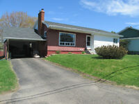 Wonderful in town, fully developed bungalow on nice corner lot !