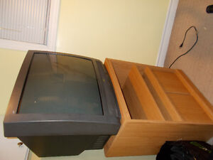 Old black TV and TV stand