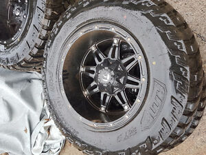 """18"""" fuel rims wrapped on brand new 35"""" amp mts"""