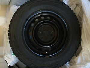 Lightly Used Winter tires from a Toyota RAV 4 (already on rims)