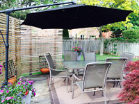 Cantilevered umbrella and patio table with 6 chairs