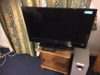 "32"" lcd TV with sub and speakers"