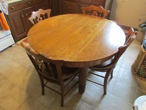 Antique hardwood dining table circa early 1900 with 4 chairs
