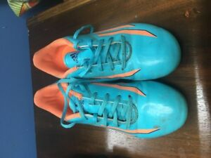 Youth size 3 Adidas soccer cleats and shin pads