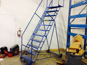 BEST PRICE ROLLING LADDERS. NEW AND USED. ( SALE PRICING )