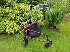 Red 3 wheel folding rollator/walker/stroller