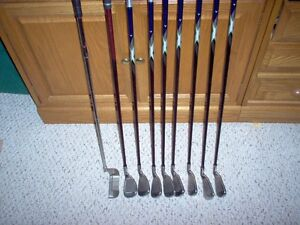 Left Handed Callaway 22 set of irons and a putter