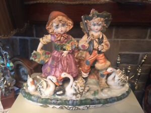 vintage Capodimonte figurine of a young couple with geese.