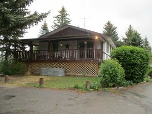 PRICE REDUCED! 4 BDRM Bungalow on 4 acres