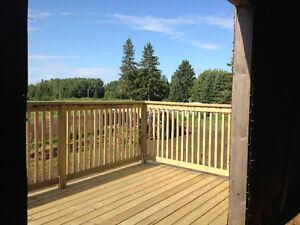 One Bedroom, private deck and yard, main floor