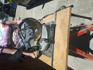 Like new Mitre chop saw with table and stand $100