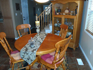 Dining table 4 chairs and hutch for sale