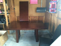 Solid dining room table with 4 chairs and leaf