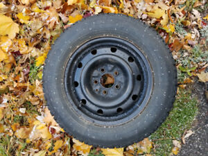 Set of 4 used Magna Grip winter tires on steel rims