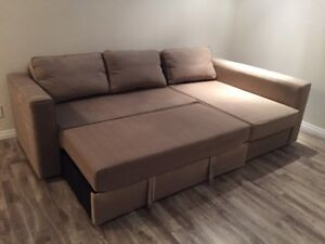 Beige sectional with pullout bed